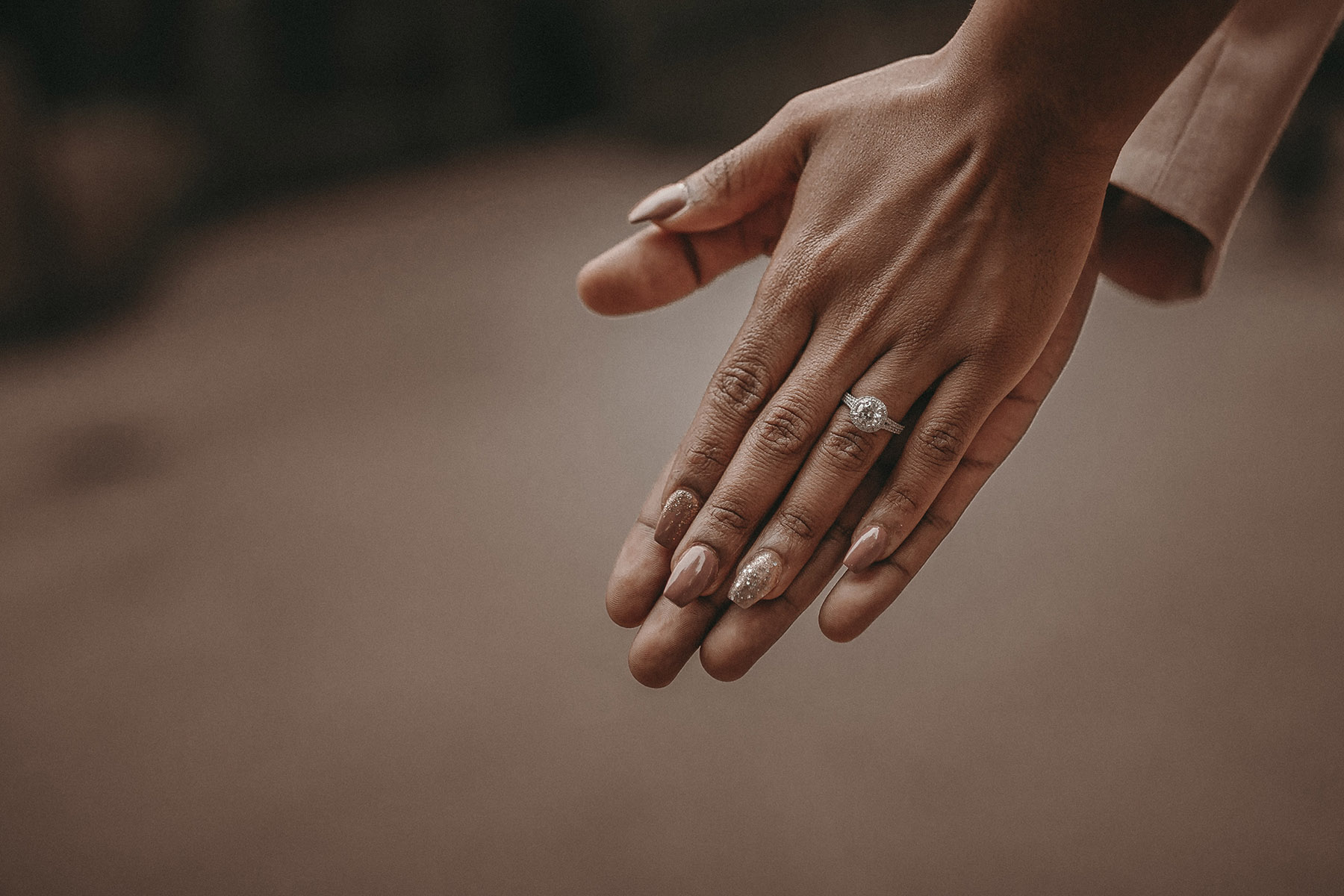 Couple showing off diamond engagement ring